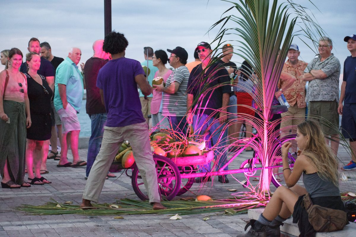Man cutting coconuts at Mallory Square Key West FL